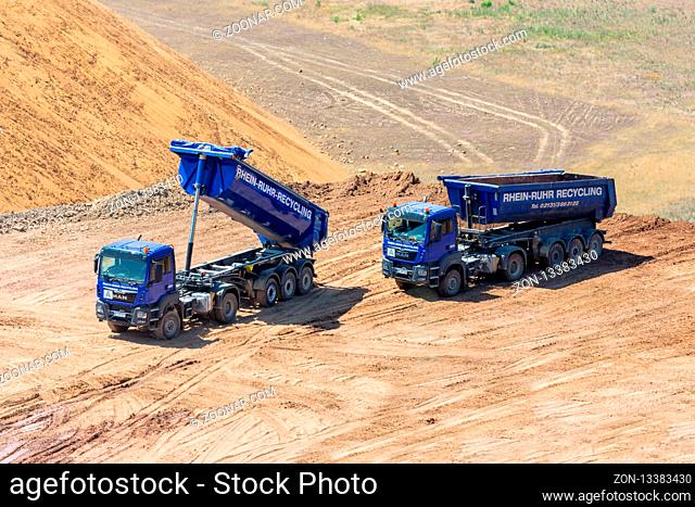Garzweiler lignite mine, Germany - June 27, 2018: Brown coal open pit landscape with dumper trucks in Garzweiler mine Germany
