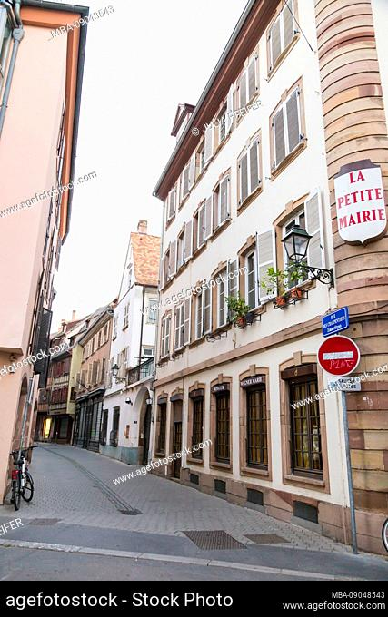 Narrow street or lane in Strasbourg, Alsace, France lined with quaint historical houses and a no entry sign for traffic with parked bicycle