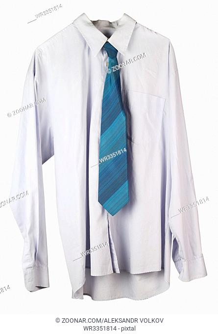 Old wrinkled washed blue shirt and tie is hanging on a hanger. Isolated on white with patch studio shot