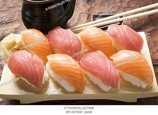 Nigiri sushi and preserved ginger on sushi board