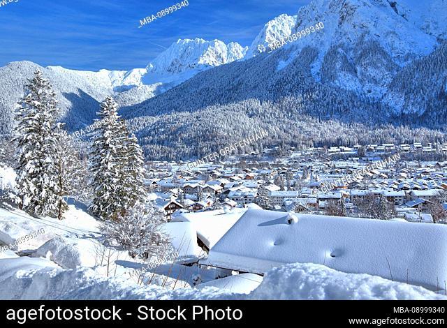 Panoramic view over the village against Karwendel mountains with Wörner in winter, Mittenwald, Werdenfelser Land, Upper Bavaria, Bavaria, Germany