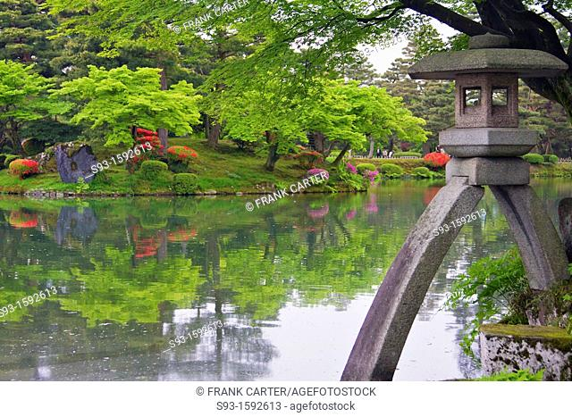 A view of Kenroku-en garden in the Spring with a stone lantern in the fore ground