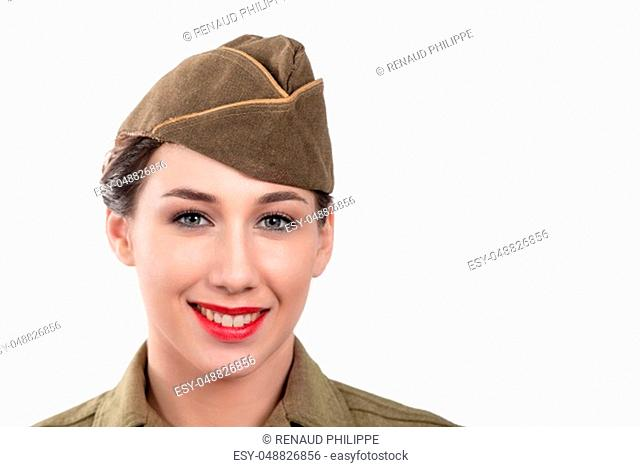 a pretty young woman in ww2 uniform us with garrison cap on white background