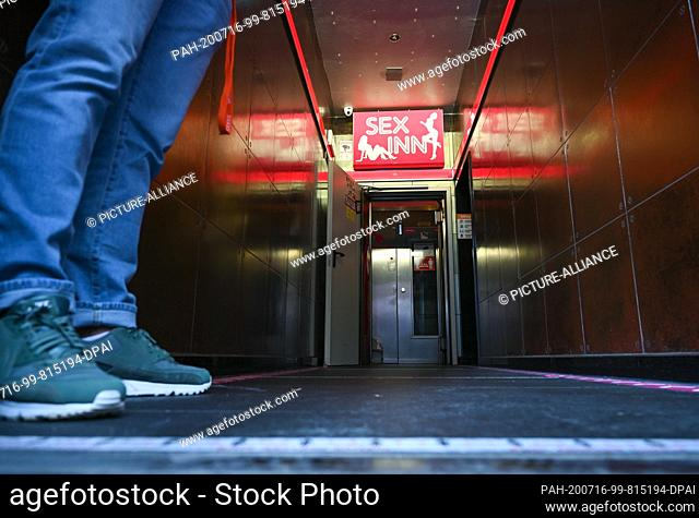 """16 July 2020, Hessen, Frankfurt/Main: A doorman stands at the entrance of the """"""""Sex Inn"""""""" running house in Frankfurt's station district"""