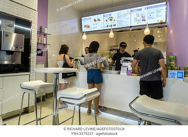 Diners choose their lunch in the SnowFox cafe sushi restaurant in the Flatiron neighborhood of New York on Tuesday, July 2, 2019