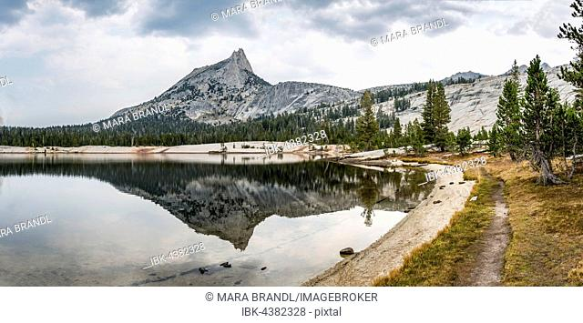 Trail at the lake, mountains reflected in a lake, Cathedral Peak, Lower Cathedral Lake, Sierra Nevada, Yosemite National Park, Cathedral Range, California, USA