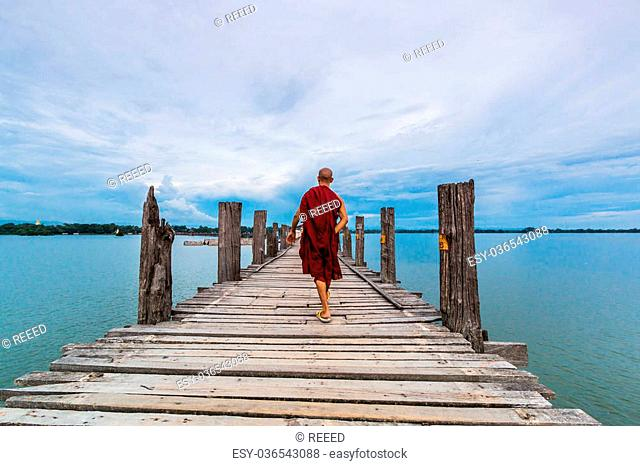 Mandalay - U Bein Bridge, Myanmar-Aug 26th, 2014: Myanmar monks