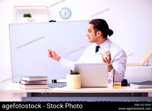 Doctor teaching during the lecture in university