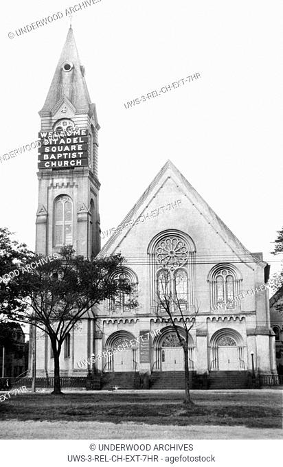 Charleston, South Carolina: c. 1921 The Citadel Square Baptist Church uses a big electric sign on its steeple to welcome visitors
