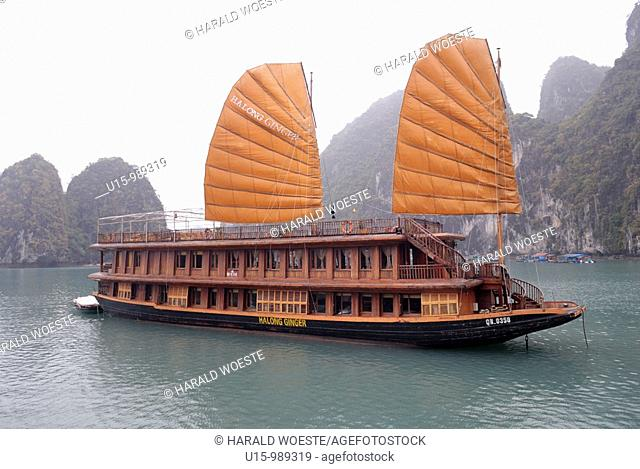 Asia, Vietnam, Halong Bay  Traditionally styled sailing junk on the Halong Bay  Designated a UNESCO World Heritage Site in 1994