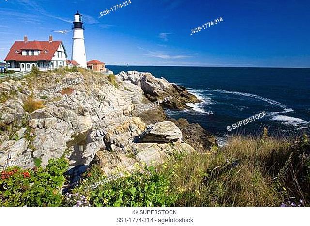 Lighthouse at the coast, Portland Head Lighthouse, Cape Elizabeth, Maine, USA