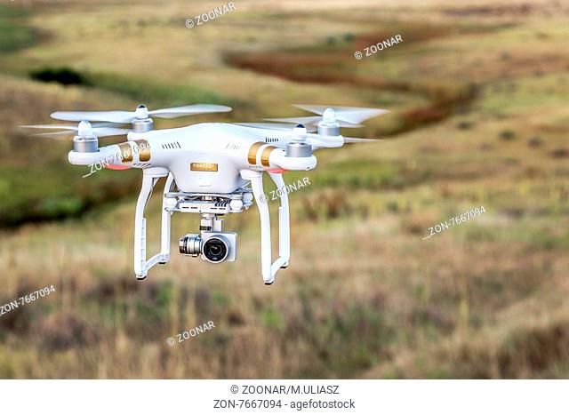 FORT COLLINS, CO, USA, AUGUST 28, 2015: Airborne radio controlled Phantom 3 quadcopter drone flying with a camera over prairie