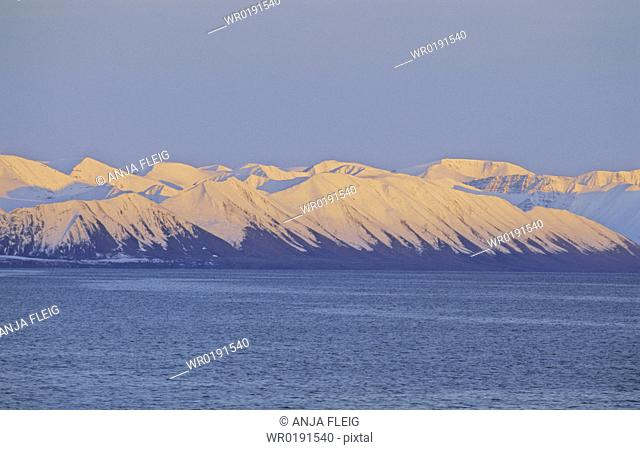 Pinkish evening sun on the mountain slopes of Northern Spitsbergen