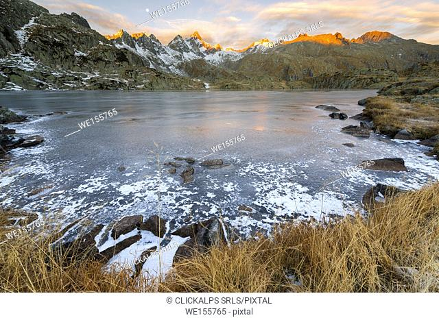 Italy, Trentino Alto Adige, Adamello Brenta Park, Nambrone valley, Dawn at Black Lake, in background Presanella group sunlit
