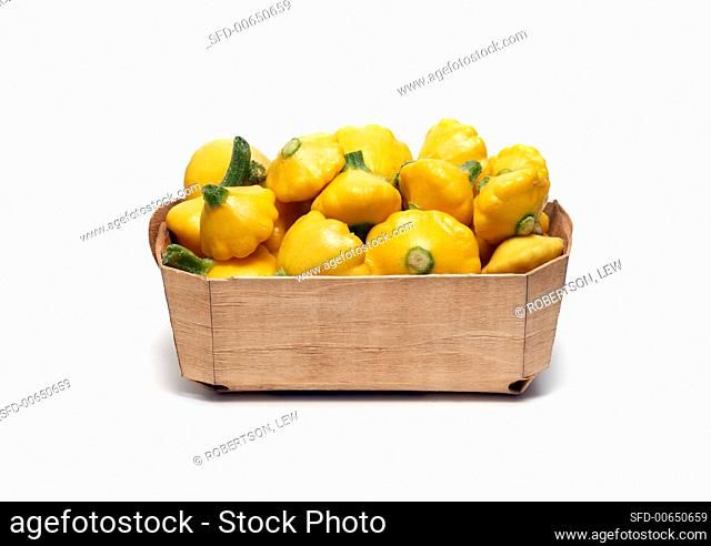 Baby Yellow Squash in Wooden Basket on White Background
