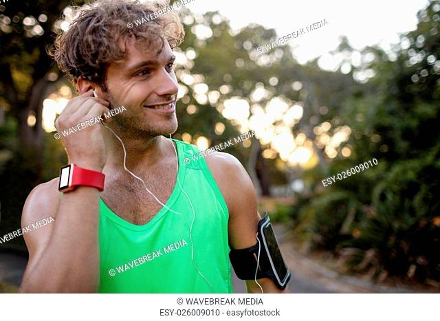 Man listening to music while jogging