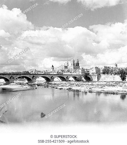 France, Orleans, Arch bridge with river Loire