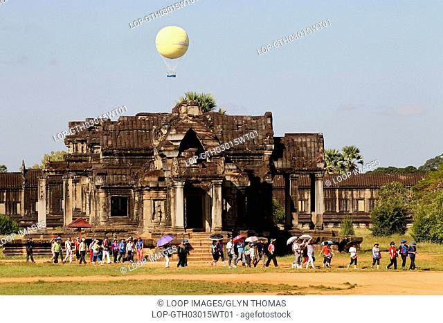 A group of tourists at Angkor Wat temple in Cambodia