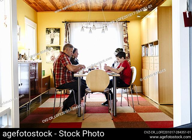 Side view of dining room with family sitting in table