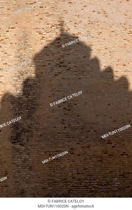 Tunisia - Kairouan - Shadow of a minaret on a wall inside the medina