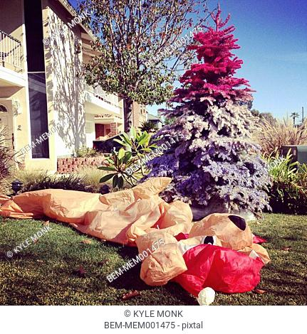 Deflated Christmas decorations in yard