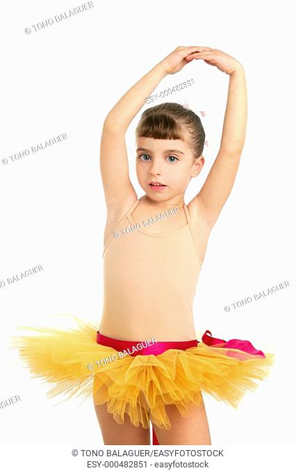 Ballerina little girl portrait posing at studio white background