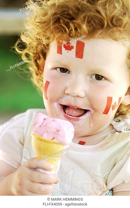 Little Girl with Canadian Flags on her face Eating Ice-Cream