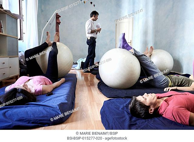 Reportage on a midwife in Lyon, France. Post-partum abdominal and pelvic floor group rehabilitation session. These exercises enable the women to feel their...