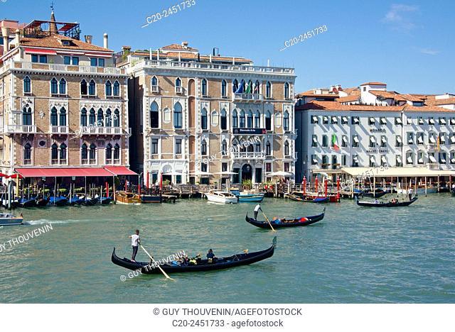 Gondolas, Gondoliers and tourists, Hotel Bauer, Palace facades, Canal Grande, Venice, Venetia, Italy