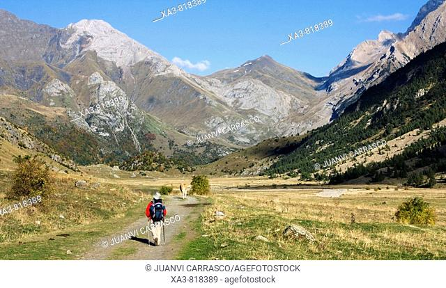 Trekker walking at Otal valley, Huesca province, Spanish Pyrenees