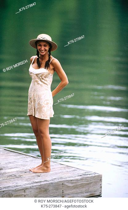Pretty girl standing on a dock