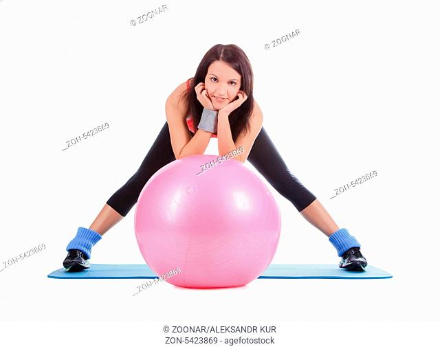 Young female with fitball over white