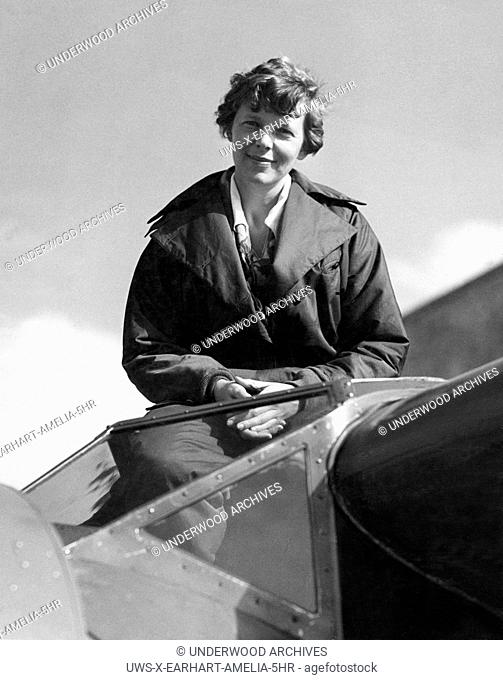 United States: c. 1936.Amelia Earhart in the cockpit of her Lockheed Electra airplane
