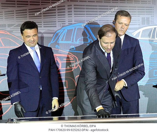Andrey Vorobyov (left to right), governor of the Moscow district, Denis Manturov, Russia's Minister for Industry, and Markus Schafer, from Mercedes-Benz Cars