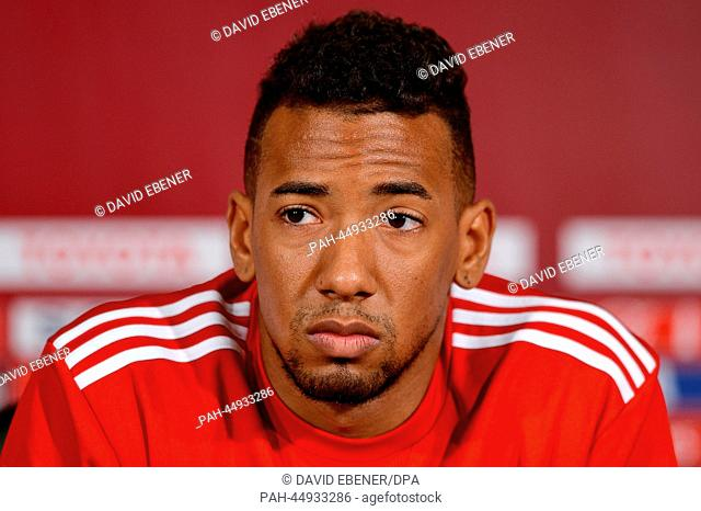 """Jerome Boateng talks during a press conference with FCBayern Munich at the stadium""""""""Stade Adrar"""""""" in Agadir, Morocco, 20December 2013"""