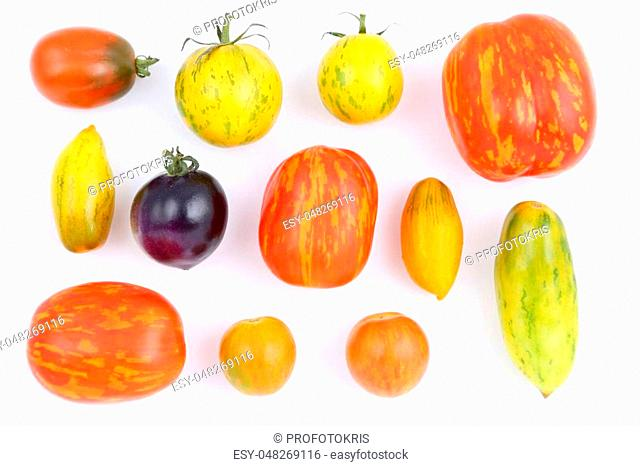 Colorful different kind tomatoes on white background
