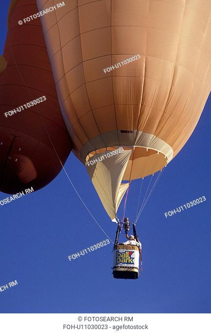 hot air balloon, Atlanta, GA, Georgia, Hot air balloon shaped like a hot dog in a bun, advertising Ball Park Franks, rises up in the sky at the Dogwood Festival...