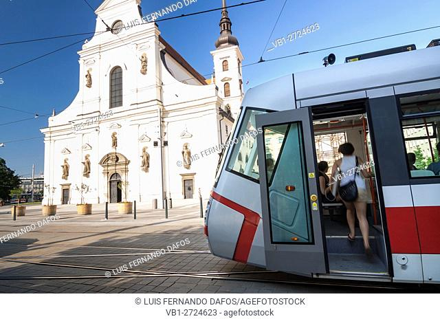 Tram and passengers by St. Thomas church at Moravian Square. Brno, Czech Republic