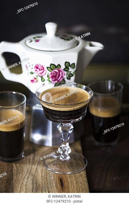 Coffee served in a vintage coffee-maker with glasses