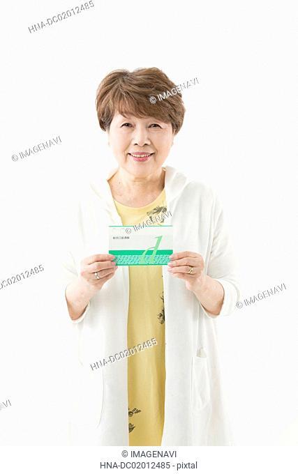 Senior woman showing passbook