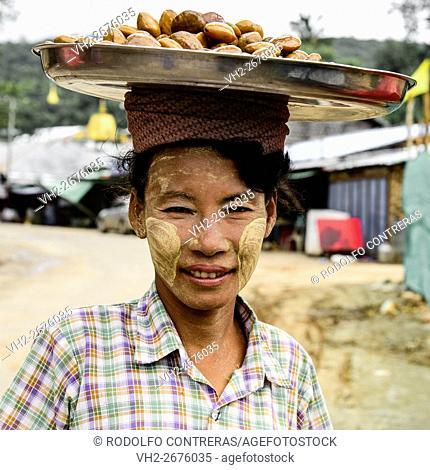 Girl carrying food in Myanmar