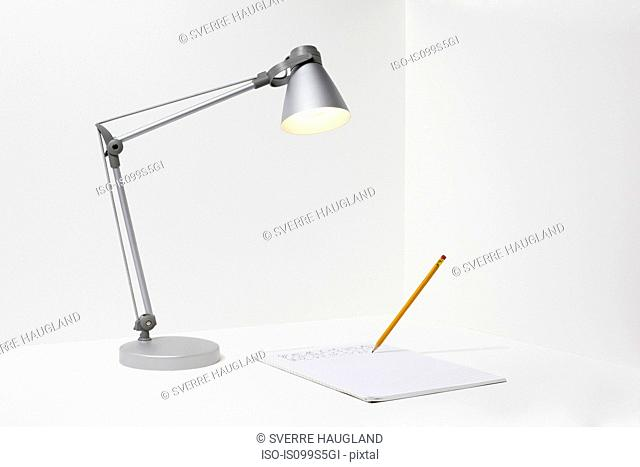 Lamp, pencil and paper