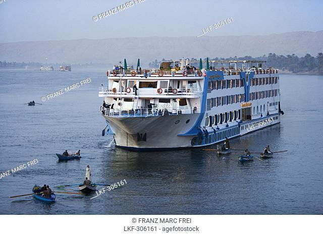 Souvenir vendors in small boats and cruise ship, Edfu, Egypt, Africa