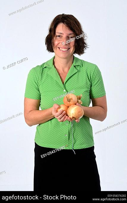 woman with onion on white background