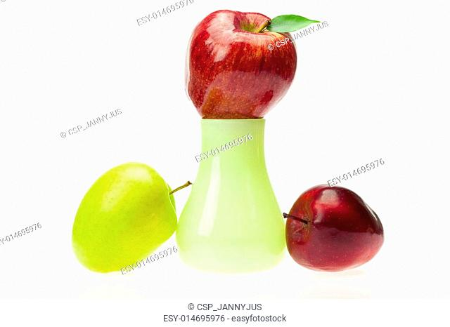 apples with green leaves in the vase  isolated on white