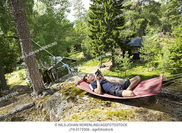 Young man in hammock, Stockholm archipelago