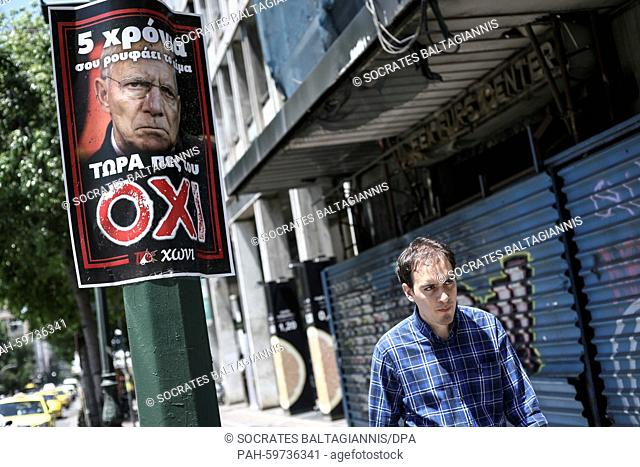"""Poster picturing the Germany's Federal Minister of Finance Wolfgang Schäuble that reads """"""""5 years he sucks your blood - Now say NO to him"""""""" in Athens"""