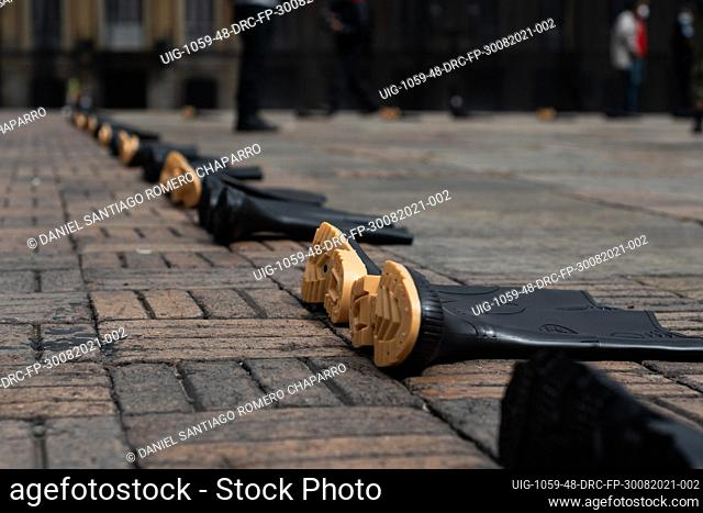 Sets of rubber boots are set in the ground as flase positive victims were found with these on after being killed during the commemoration of the international...