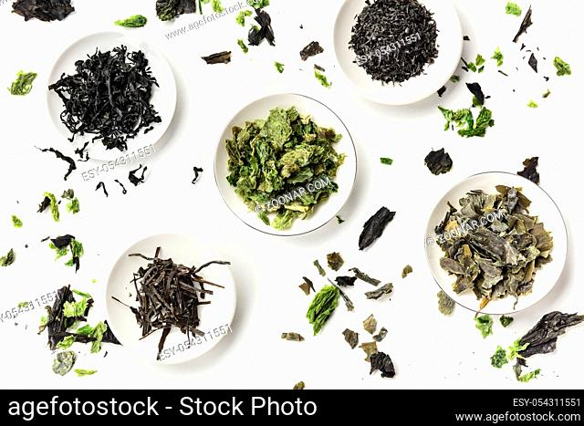 Various dry seaweed, sea vegetables, shot from the top on a white background. Superfoods background