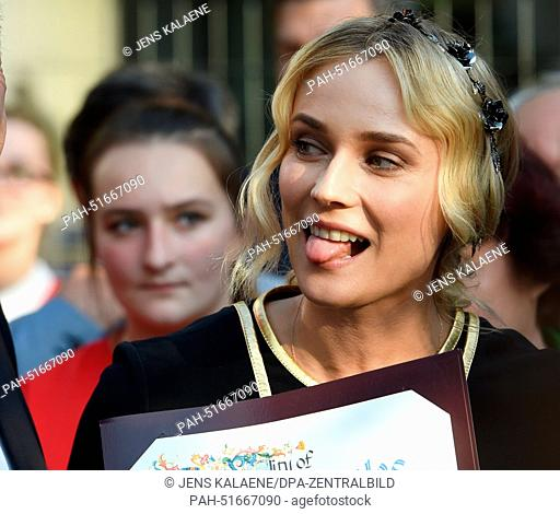Actress Diane Kruger sticks out her tongue during the re-opnening of the 'Boulevard of the Stars' at Potsdamer Platz inBerlin, Germany, 04 September 2014